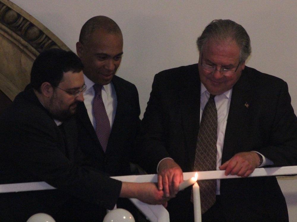 Rabbi Rachmiel Liberman (left) assisted Gov. Deval...