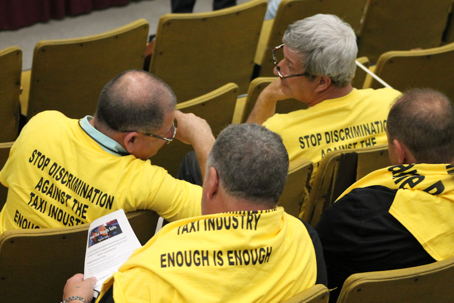Taxi drivers and  advocates gathered Tuesday ahead