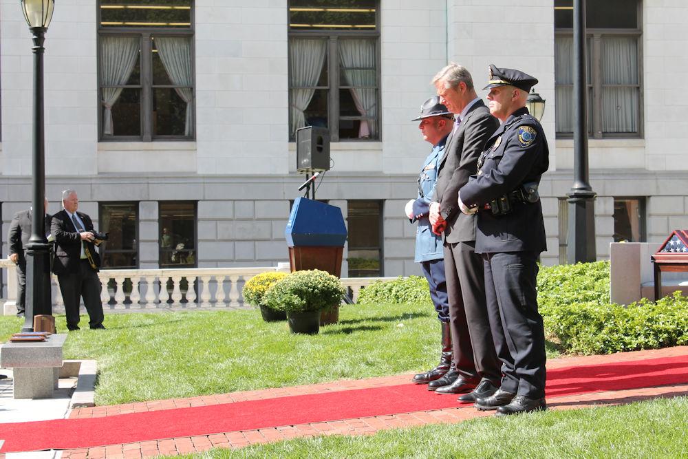 Gov. Charlie Baker paused for a moment of silence