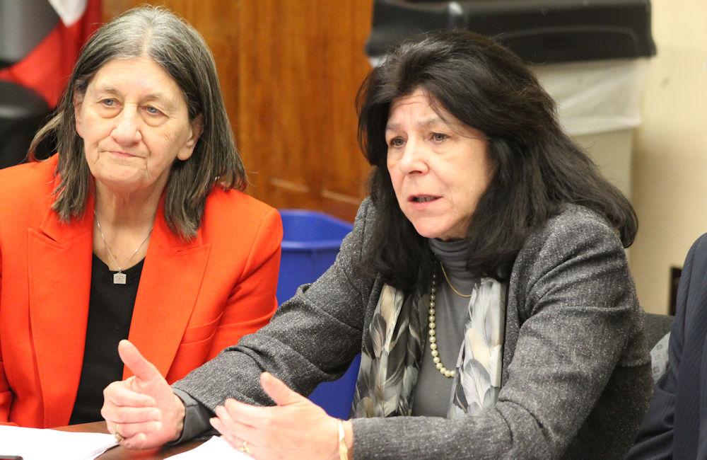Newburyport Mayor Donna Holaday (center) encourage